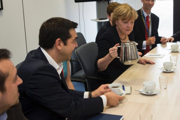 Greek Prime Minister Tsipras and German Chancellor Merkel attend a meeting prior to a euro zone leaders summit in Brussels