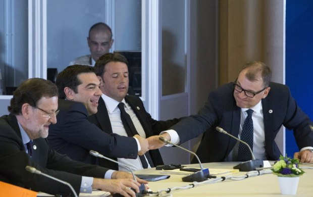 Spanish PM Rajoy, Greek PM Tsipras, Italian PM Renzi and Finnish PM Sipila take part in a euro zone EU leaders emergency summit on the situation in Greece in Brussels