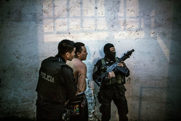 A suspected gang member detained by police in San Salvador. PHOTOGRAPH BY MANU BRABO/AP