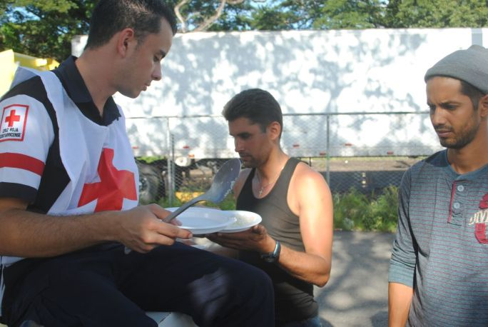 Costa Rica's Red Cross spoons out food to the Cubans stuck on the border