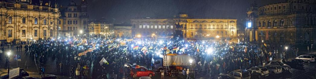 Right Tilt The number of right-wing demonstrations like this one in Dresden, which occurs every Monday, has grown since Merkel announced her policy on migrants