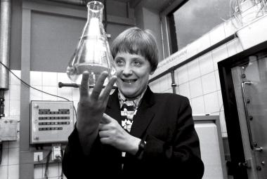 A Scientist First Merkel earned a Ph.D. in quantum chemistry before entering politics; here she holds a beaker of water while serving as Environment Minister in the 1990s