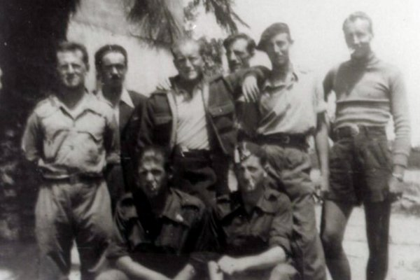 Delmer Berg, standing second from right wearing a beret, with the Abraham Lincoln Brigade in Spain around 1938. Credit Abraham Lincoln Brigade Archives