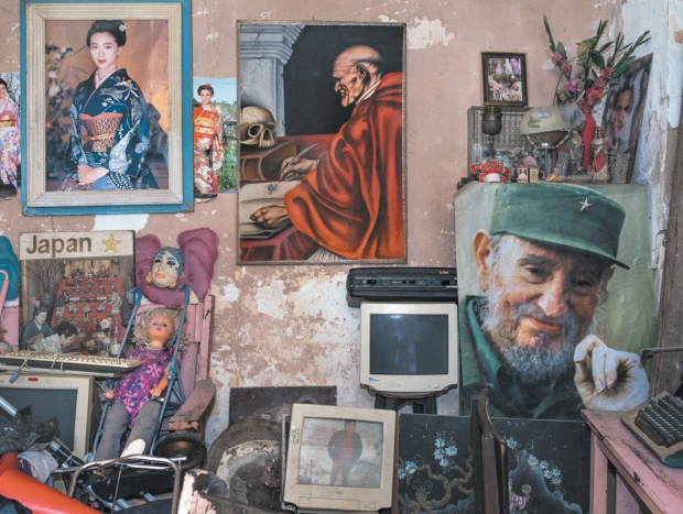 Magnum Photos . A living room in Havana with a poster of Fidel Castro at right, 2015; photograph by Carl De Keyzer from his book Cuba, La Lucha, which includes an essay by Gabriela Salgado and has just been published by Lannoo. His photographs are on view at the Roberto Polo Gallery, Brussels, through May 15.