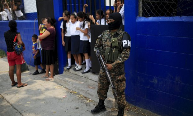 A member of a combined army-police unit secures a school in Soyapango before their deployment to deal with gang violence El Salvador last month. Photograph: Jose Cabezas/Reuters