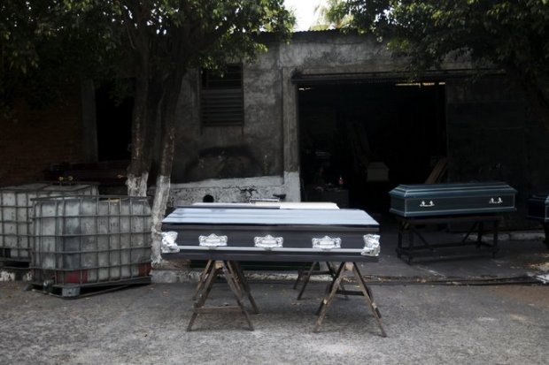 Coffins outside a factory in Jucuapa, El Salvador, a country where there are more than 20 homicides a day. A gang truce had been credited with lowering the homicide rate in 2012 and 2013. Credit Jose Cabezas/Reuters