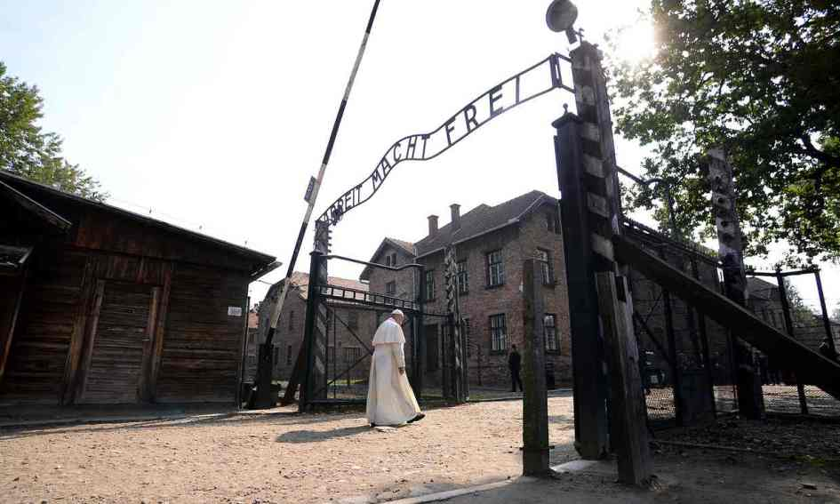 Pope Francis walks through the gate of Auschwitz on Friday. Photograph: Filippo Monteforte/AP