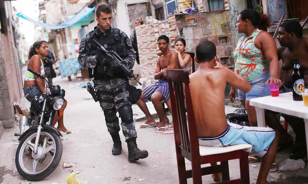 Favelas are often flooded with police. Photograph: Mario Tama/Getty Images