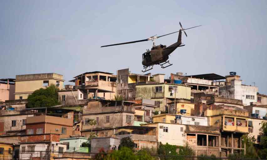 The Maré favela is one of many poor communities that continue to suffer despite the growth and media attention surrounding the Rio 2016 Olympics. Photograph: Buda Mendes/Getty Images