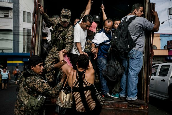 Soldiers transporting civilians in San Salvador in July 2015 after gangs ordered a bus strike. Fred Ramos / El Faro for The New York Times
