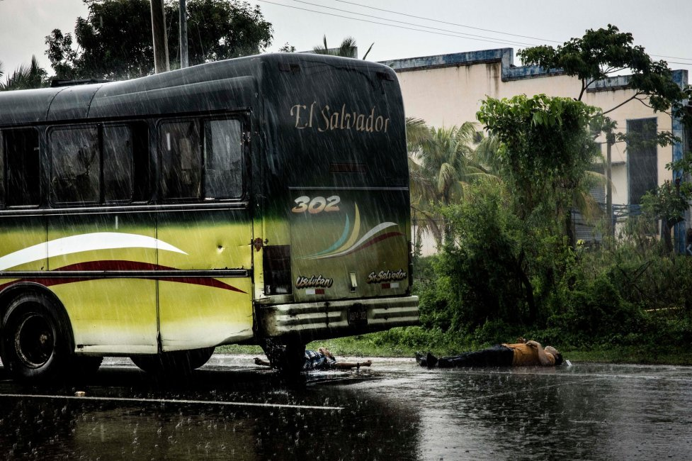 The scene after gang members in Olocuilta, El Salvador, killed six people on a bus in 2014 because the owner refused to pay extortion. Fred Ramos / El Faro