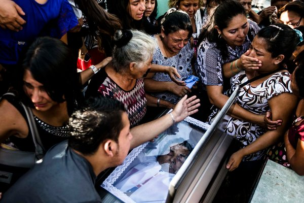 Friends and relatives mourned Ricardo Amador, a bus driver killed by gang members, in Aguilares, El Salvador, in September. Fred Ramos / El Faro for The New York Times